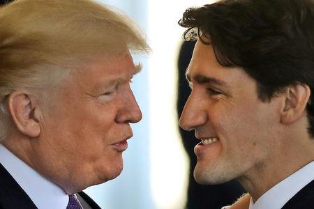 FILE PHOTO: Canadian Prime Minister Justin Trudeau is greeted by U.S. President Donald Trump prior to holdiing talks at the White House in Washington