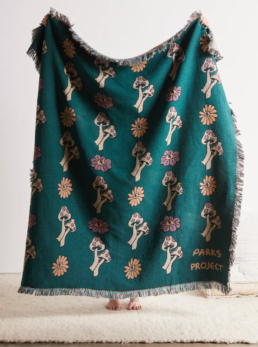 """<br><br><strong>Parks Project</strong> Parks Project Power To The Parks Floral Throw Blanket, $, available at <a href=""""https://go.skimresources.com/?id=30283X879131&url=https%3A%2F%2Fwww.urbanoutfitters.com%2Fshop%2Fparks-project-power-to-the-parks-floral-throw-blanket"""" rel=""""nofollow noopener"""" target=""""_blank"""" data-ylk=""""slk:Urban Outfitters"""" class=""""link rapid-noclick-resp"""">Urban Outfitters</a>"""
