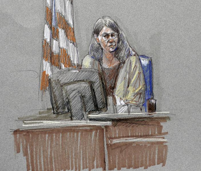Joleen Cahill, wife of Michael Cahill who was killed in the Fort Hood shootings, is depicted in a courtroom sketch at the Lawrence William Judicial Center during the sentencing phase for Maj. Nidal Hasan, Tuesday, Aug. 27, 2013, in Fort Hood, Texas. Hasan was convicted of killing 13 of his unarmed comrades in the deadliest attack ever on a U.S. military base. (AP Photo/Brigitte Woosley)