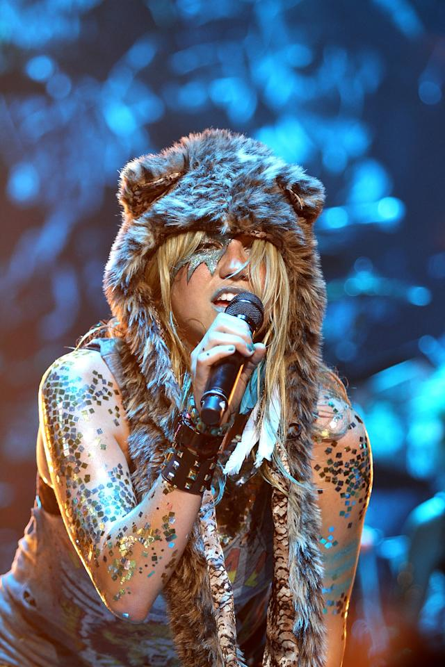 This is Ke$ha dressing up as David Bowie dressing up as a bear (at Casio's Shock The World concert in 2010).