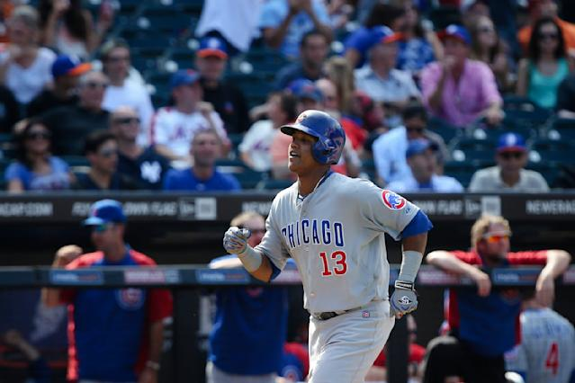 Chicago Cubs' Starlin Castro (13) runs home after hitting the game-winning home run during the ninth inning of a baseball game against the New York Mets, Sunday, Aug. 17, 2014, in New York. The Chicago Cubs won 2-1. (AP Photo/John Minchillo)