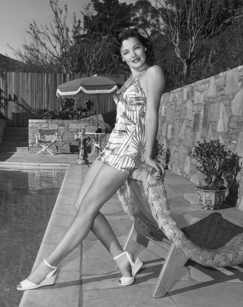 <p>American actress Gene Tierney wearing a plant-printed swimming look with white wedges. </p>