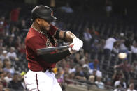 Arizona Diamondbacks' Ketel Marte hits a single against the Los Angeles Angels in the first inning during a baseball game, Sunday, June 13, 2021, in Phoenix. (AP Photo/Rick Scuteri)