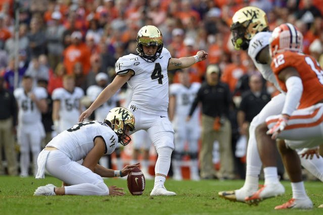 Wake Forest's Nick Sciba (4), with Dom Maggio holding, boots a field goal during the first half of an NCAA college football game against Clemson, Saturday, Nov. 16, 2019, in Clemson, S.C. (AP Photo/Richard Shiro)