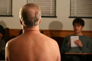 Back of naked man, facing interviewer