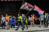 Some protesters carried banners in support of former US president Donald Trump (AFP/William WEST)