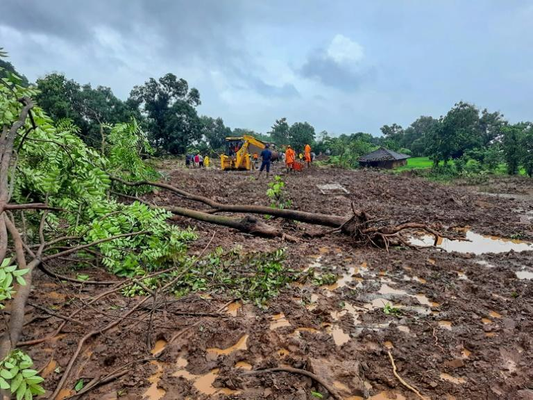 Rescuers look for survivors at the site of a landslide in Raigad district, Maharashtra