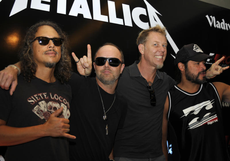 US heavy metal and rock band Metallica members from left to right  Kirk Hammett, Lars Ulrich, James Hetfield and Robert Trujillo pose for media during a press conference, in Gurgoan on the outskirts of  New Delhi, India, Friday, Oct. 28, 2011. According to Indian news agency Press Trust of India, rock band Metallica's maiden concert in India failed to kick off Friday triggering chaos at the venue and leaving thousands of fans disappointed. After citing technical problems for the postponement, the concert organizers said concert will be held tomorrow. (AP Photo/Tsering Topgyal)