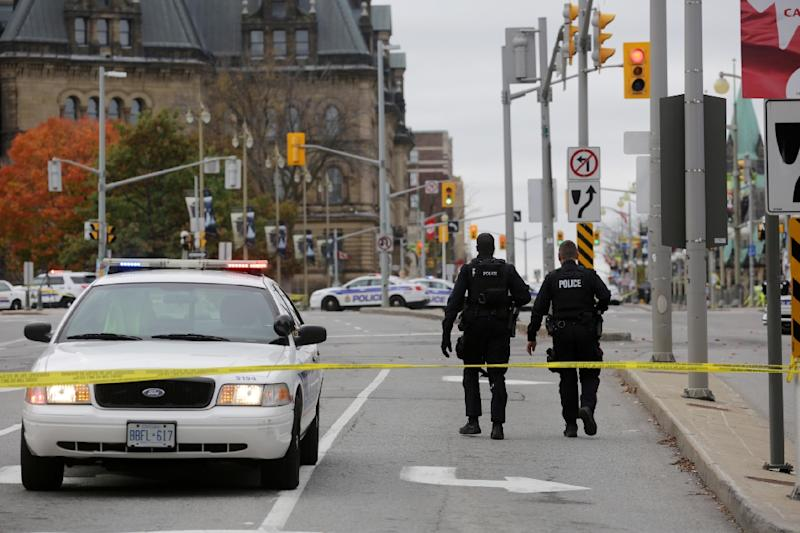 Police officers patrol in Ottawa, Canada, on October 22, 2014