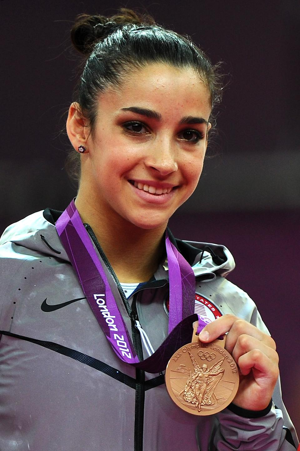 """Bronze medalist <a href=""""http://sports.yahoo.com/olympics/gymnastics/alexandra-raisman-1134192/"""" data-ylk=""""slk:Alexandra Raisman"""" class=""""link rapid-noclick-resp"""">Alexandra Raisman</a> of the United States poses on the podium during the medal ceremony for the on Day 11 of the London 2012 Olympic Games at North Greenwich Arena on August 7, 2012 in London, England. (Photo by Michael Regan/Getty Images)"""
