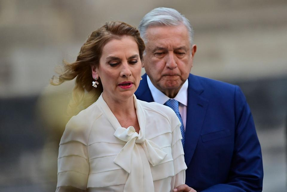 Mexican President Andres Manuel Lopez Obrador (R) and his wife, First Lady Beatriz Gutierrez, arrive for a ceremony to mark the 100th day of his third year in office, at the National Palace in Mexico City, on March 30, 2021. (Photo by Pedro PARDO / AFP) (Photo by PEDRO PARDO/AFP via Getty Images)
