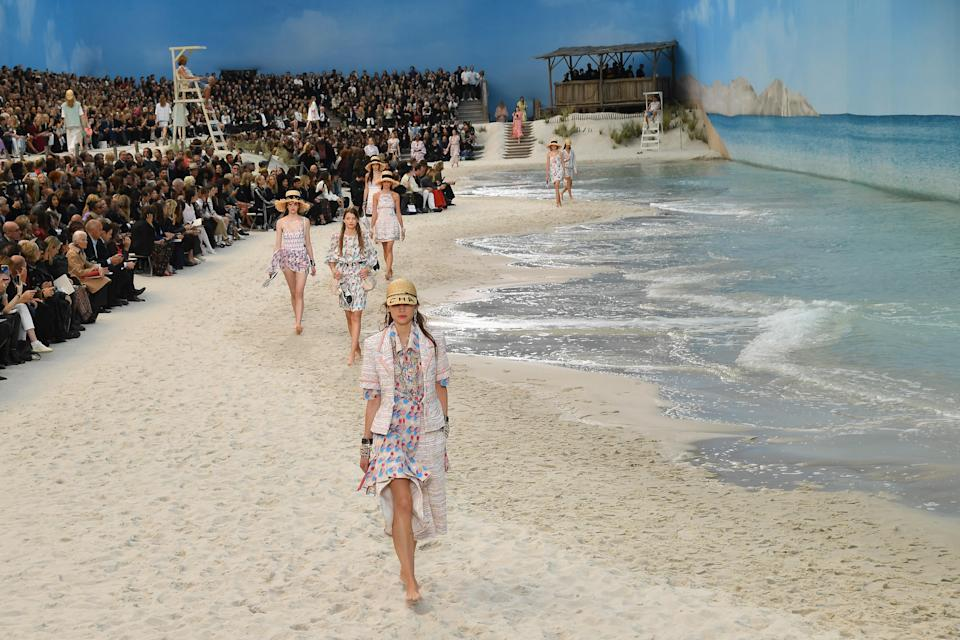 <p>In October 2018, the Grand Palais was unrecognisable as lifeguards took to their posts decked in Chanel clobber ahead of the SS19 show. Models walked a sand-laden runway in straw hats while faux waves swept in. <em>[Photo: Getty]</em> </p>