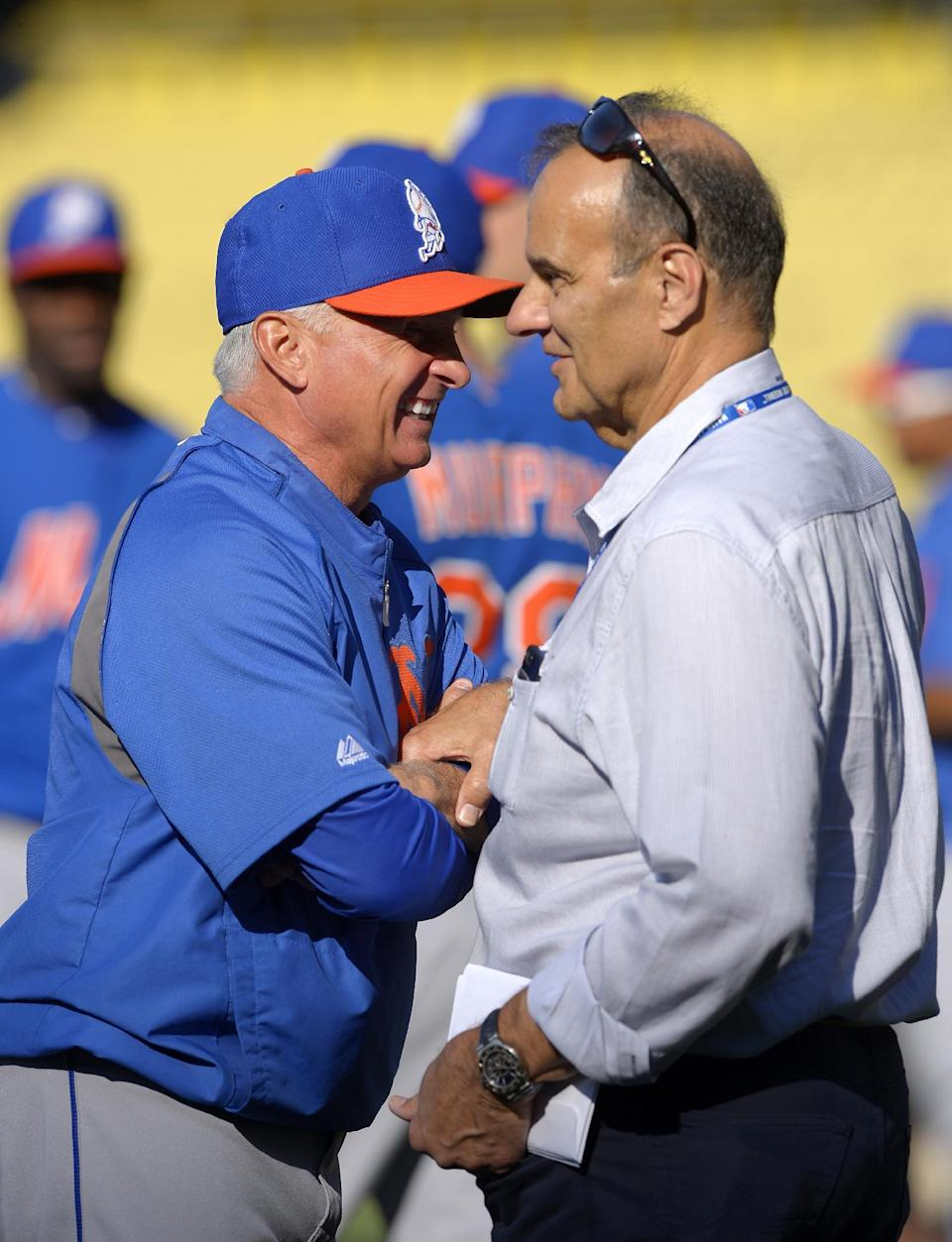 New York Mets manager Terry Collins, left, talks with MLB executive vice president of baseball operations Joe Torre during batting practice before their baseball game against the Los Angeles Dodgers, Monday, Aug. 12, 2013, in Los Angeles. (AP Photo/Mark J. Terrill)