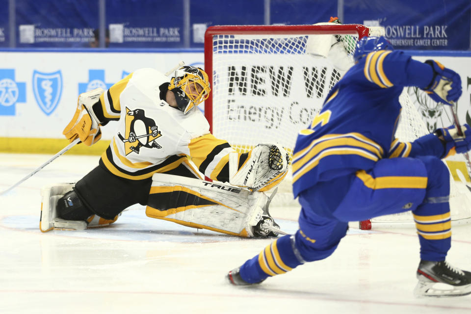 Buffalo Sabres forward Arttu Ruotsalainen (25) puts the puck past Pittsburgh Penguins goalie Casey DeSmith (1) during the first period of an NHL hockey game, Sunday, April 18, 2021, in Buffalo, N.Y. (AP Photo/Jeffrey T. Barnes)