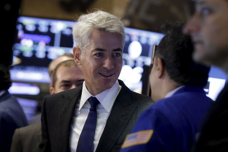 Activist investor Bill Ackman, chief executive of Pershing Square Capital, speaks with a specialist trader on the floor of the New York Stock Exchange