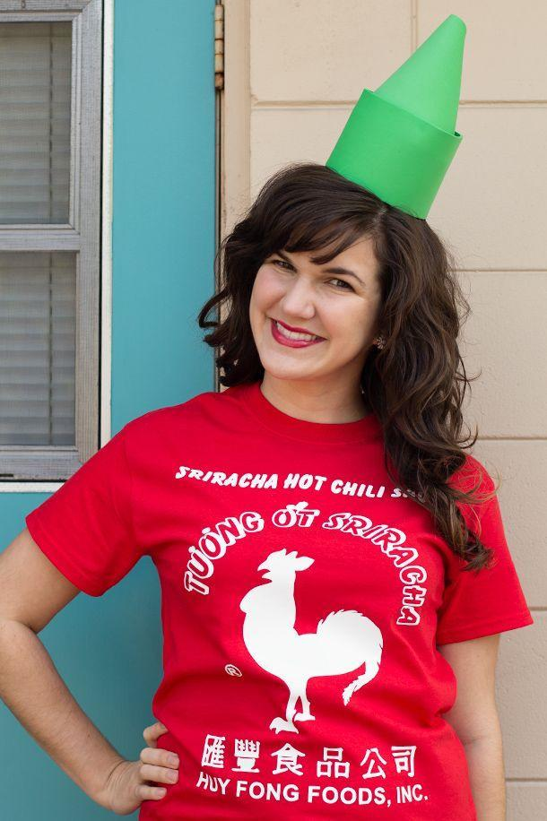 """<p>Want to be the hottest one on Halloween? Go as a Sriracha bottle. The t-shirt shown was a DIY, but if you're not into that, you can save yourself some time and just <a href=""""http://www.amazon.com/Sriracha-Mens-Chili-Sauce-T-Shirt/dp/B00DC1EPZU?tag=syn-yahoo-20&ascsubtag=%5Bartid%7C1782.g.3038%5Bsrc%7Cyahoo-us"""" rel=""""nofollow noopener"""" target=""""_blank"""" data-ylk=""""slk:buy a pre-made one"""" class=""""link rapid-noclick-resp"""">buy a pre-made one</a>. </p><p>Get the instructions <a href=""""http://sarahhearts.com/2013-10-29/diy-sriracha-costume/"""" rel=""""nofollow noopener"""" target=""""_blank"""" data-ylk=""""slk:here"""" class=""""link rapid-noclick-resp"""">here</a>. </p>"""