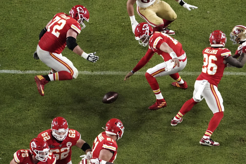 Kansas City Chiefs quarterback Patrick Mahomes (15) goes after a loose ball after it was knocked out of his Mahomes' hands during the second half of the NFL Super Bowl 54 football game Sunday, Feb. 2, 2020, in Miami Gardens, Fla. (AP Photo/Morry Gash)