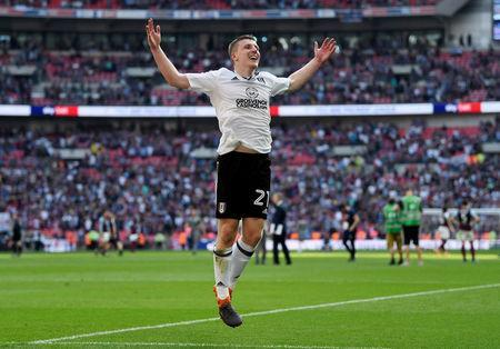 Soccer Football - Championship Play-Off Final - Fulham vs Aston Villa - Wembley Stadium, London, Britain - May 26, 2018 Fulham's Matt Targett celebrates promotion to the Premier League. Action Images via Reuters/Tony O'Brien