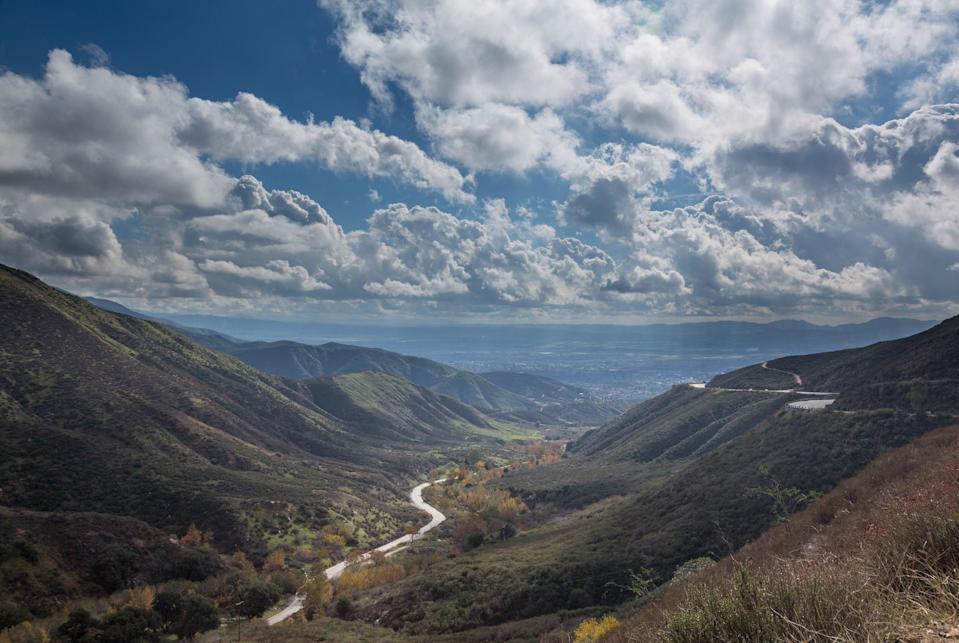 """<p><strong>Tell me: What's this place all about?</strong><br> The 110-mile-long Rim of the World Scenic Byway, with its steep climb and sweeping cliffside views of the San Bernardino Mountains, is one of the most under-trafficked <a href=""""https://www.cntraveler.com/gallery/best-west-coast-road-trips?mbid=synd_yahoo_rss"""" rel=""""nofollow noopener"""" target=""""_blank"""" data-ylk=""""slk:road trips in SoCal"""" class=""""link rapid-noclick-resp"""">road trips in SoCal</a>.</p> <p><strong>What's it like being there?</strong><br> Awe inspiring views, perfect for the off-the-beaten-path traveler.</p> <p><strong>Is there a guide involved?</strong><br> Nope.</p> <p><strong>Who comes here?</strong><br> Anyone looking for the road less traveled in SoCal.</p> <p><strong>Did it meet expectations?</strong><br> Since you rarely hear about The Rim of the World, it's a real treat, especially if you happen to be there in wildflower season, when the roadsides are paved in mustard yellow flowers.</p> <p><strong>So, then, what, or who, do you think it's best for?</strong><br> Highway 1 might get all the love, but anyone who appreciates a slow drive along an iconic road should give this a try.</p>"""