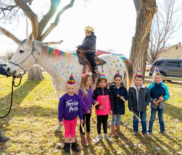 PHOTO: Wyatt Haas, a boy who loves unicorns met two in real life thanks to a send-off party from his kindergarten classmates in Fallon, Montana, on Dec. 6. (Jennifer Nielsen )
