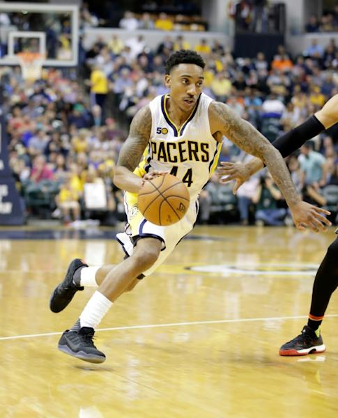 Jeff Teague of the Indiana Pacers dribbles the ball past an Atlanta Hawks player during their NBA game at Bankers Life Fieldhouse in Indianapolis, Indiana, on April 12, 2017