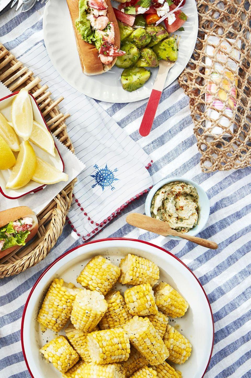 """<p>Bite-size cobettes are the ultimate summer barbecue side.</p><p><strong><a href=""""https://www.countryliving.com/food-drinks/a27546953/corn-cobettes-with-basil-butter-recipe/"""" rel=""""nofollow noopener"""" target=""""_blank"""" data-ylk=""""slk:Get the recipe"""" class=""""link rapid-noclick-resp"""">Get the recipe</a>.</strong><br></p>"""