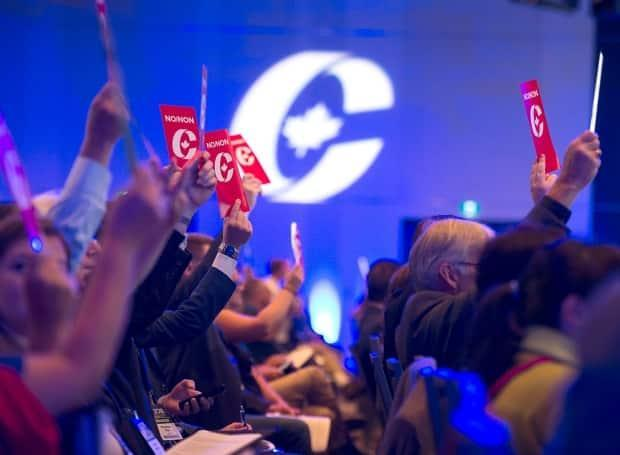 Delegates vote on party constitution items at the Conservative Party of Canada national policy convention in Halifax on Friday. (Andrew Vaughan/Canadian Press - image credit)