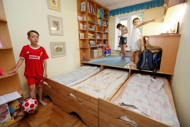 Children of Ukrainian lawmaker Yegor Sobolev and TV presenter Marichka Padalko show the apartment where their family will host fans travelling to see the Champions League final game between Real Madrid and Liverpool, in Kiev, Ukraine May 10, 2018. Picture taken May 10, 2018. REUTERS/Valentyn Ogirenko