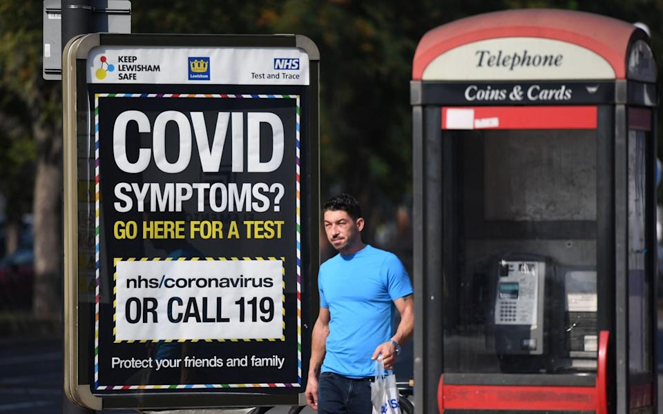 A poster in London urging anyone with symptoms to get a test - Facundo Arrizabalaga/EPA-EFE/Shutterstock