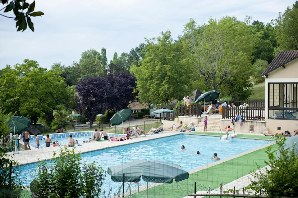 """<p><span>Located in woodland bordering one of the Dordogne valley's most historic towns, Sarlat La Caneda, </span><a href=""""https://coolcamping.com/campsites/europe/france/west-france/dordogne-lot/2270-huttopia-sarlat"""" rel=""""nofollow noopener"""" target=""""_blank"""" data-ylk=""""slk:this family-orientated campsite"""" class=""""link rapid-noclick-resp""""><span>this family-orientated campsite</span></a><span> has plenty of facilities, including indoor and outdoor pools, a shallow pool for toddlers, a games room, playground and café. Activities include canoe trips on the Dordogne and Vezere rivers, and a tour the local castles. A tent and two people from €19 (£16). [Photo: Cool Camping]</span> </p>"""