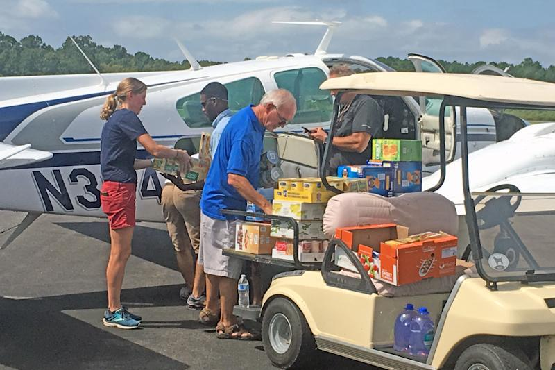 Small Charleston Airport Collecting Hurricane Florence Relief ... on stretch ez go cart, airport gate sign, airport electric transport cart, airport food cart, airport baggage claim, airport surveillance radar, flight attendant cart, airport shuttle in carts, senior citizen airport cart, airport ground equipment, airport window, airport fire stations, airport traffic pattern, porter airport cart, airport fire trucks, airport moving walkway,