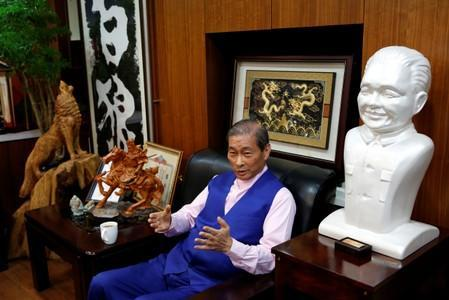 """Chang An-lo, known as """"White wolf"""", leader of the Chinese Unification Promotion Party (CUPP), sits next to a bust of China's late leader Deng Xiaoping during an interview in Taipei"""