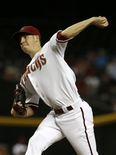 Arizona Diamondbacks' Patrick Corbin throws a pitch against the San Francisco Giants during the first inning in a baseball game Friday, June 7, 2013, in Phoenix. (AP Photo/Ross D. Franklin)