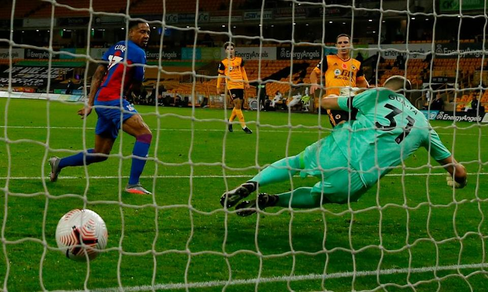 Daniel Podence (second right) scores Wolves' second goal.