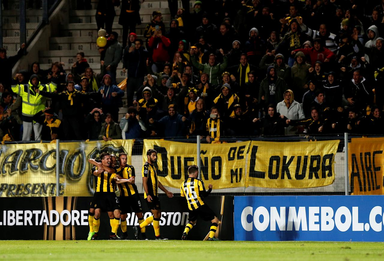 Soccer Football - Copa Libertadores - Penarol v Palmeiras - Campeon del siglo stadium - Montevideo, Uruguay - 26/4/17. Penarol's Mauricio Affonso (obscured) celebrates with teammates after scoring. REUTERS/Andres Stapff