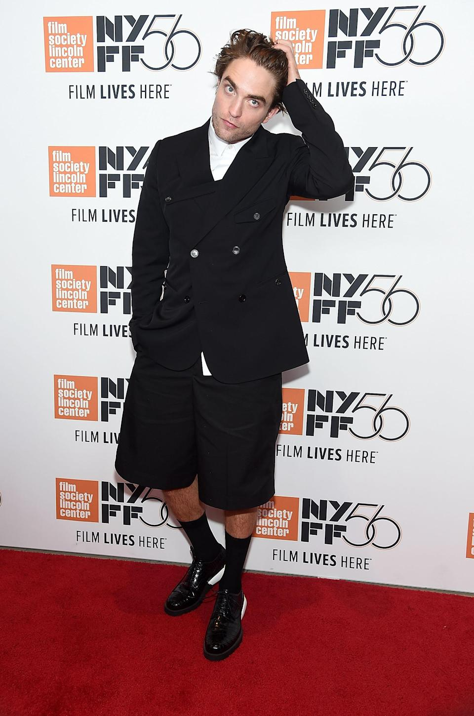 <p>Actor Robert Pattinson brought a twist to the traditional tux in a double-breasted short suit (pulled-up socks and all) by Dior Homme on October 2, 2018. <em>[Photo: Getty]</em> </p>