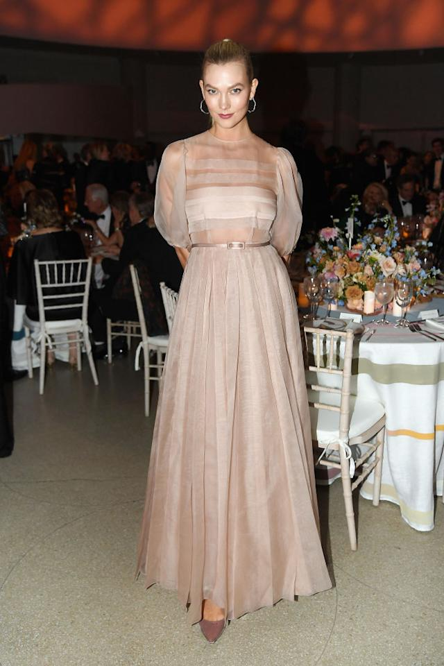 <p>Model Karlie Kloss attended the Guggenheim International Gala Dinner on November 15 in a sheer ruffled dress. Could pink be making a comeback this season? <em>[Photo: Getty]</em> </p>