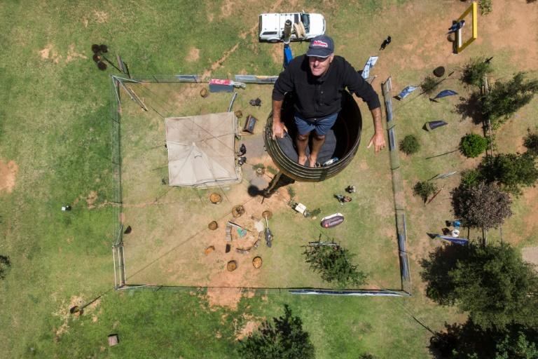 Two decades on from his initial effort, Kruger, 52, is on the verge of smashing his record for sitting in a pole 25 metres above the ground (AFP Photo/ANTOINE DEMAISON)