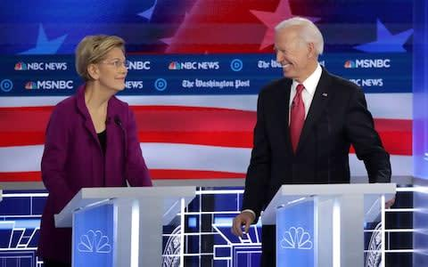 <span>Joe Biden, left, the former US vice president, continues to lead in the polls while senator Elizabeth Warren has dropped markedly</span> <span>Credit: Photo by Alex Wong/Getty Images </span>