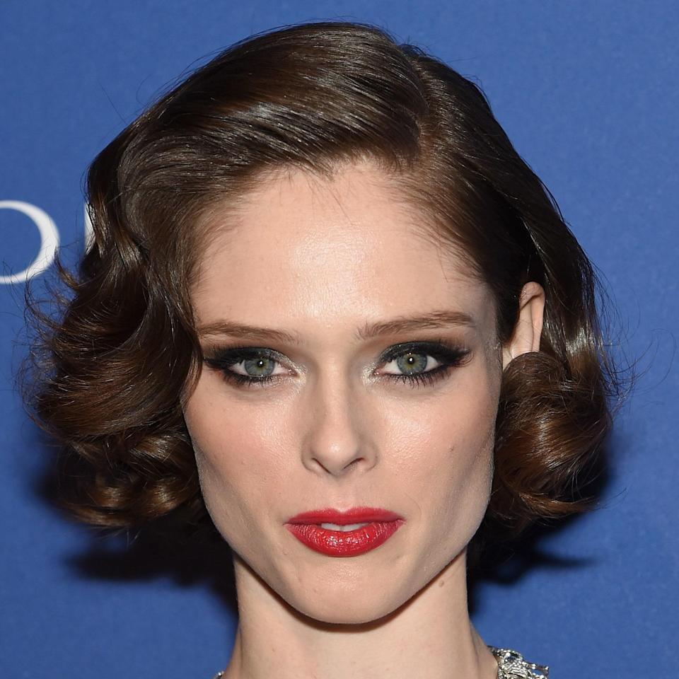 """If you couldn't tell, we love a hairstyle with an Old Hollywood feel. """"The curls turning into [Coco Rocha's] face tucked behind her ear add a whimsy and playful touch,"""" says Ferrara. """"And the hair on the heavy side of the part gives a nice frame to her face.""""<br> <br> Shorter hair is always going to require more maintenance, Ferrara notes. She recommends to get a haircut four to six months prior to the wedding day to get your desired length and shape. Go back for another haircut about 10 days before the event so your hair will be settled in and laying well. P.S.: Do a weekly <a href=""""https://www.allure.com/gallery/best-hair-masks-for-damaged-hair?mbid=synd_yahoo_rss"""" rel=""""nofollow noopener"""" target=""""_blank"""" data-ylk=""""slk:hair mask"""" class=""""link rapid-noclick-resp"""">hair mask</a> for an extra dose of hair TLC."""