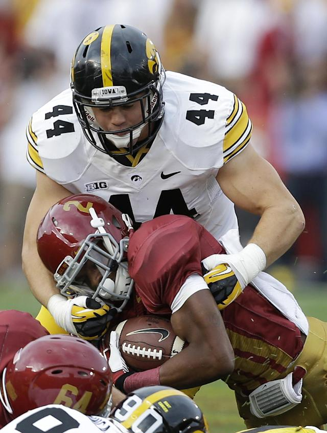 Iowa linebacker James Morris (44) tackles Iowa State running back Aaron Wimberly during the first half of an NCAA college football game, Saturday, Sept. 14, 2013, in Ames, Iowa. (AP Photo/Charlie Neibergall)