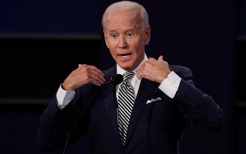 Democratic presidential nominee Joe Biden participates in the first 2020 presidential campaign debate with U.S. President Donald Trump held on the campus of the Cleveland Clinic at Case Western Reserve University in Cleveland  - REUTERS