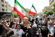 Supporters of Ahmadinejad rallied outside when the former president registered to run again on May 12, 2021