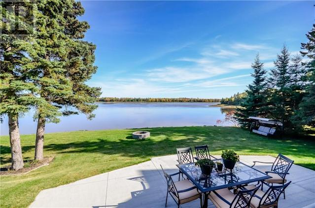 <p><span>57 Clear View Rd., Grand Barachois, N.B.</span><br> Outside, you'll be able to relax on the patio and take in some stunning views.<br> (Photo: Zoocasa) </p>
