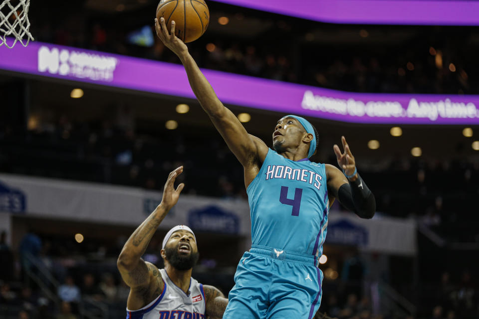 Charlotte Hornets guard Devonte' Graham (4) drives to the basket against Detroit Pistons forward Markieff Morris in the first half of an NBA basketball game in Charlotte, N.C., Friday, Nov. 15, 2019. Charlotte won 109-106. (AP Photo/Nell Redmond)