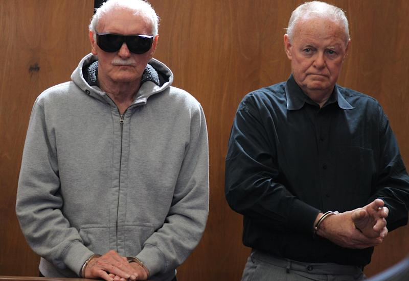 """Howard """"Howie"""" Winter, left and James Melvin listen during their arraignment at Somerville District Court on Friday, June 8, 2012 in Somerville, Mass. Winter, 83, and Melvin, 70, were arrested Thursday after authorities said they tried over several months to extort $35,000 from each of two men who had arranged a $100,000 loan for a third man. Both men pleaded not guilty to attempted extortion and conspiracy charges. Winter is the former head of the Winter Hill Gang, that was later run by James """"Whitey"""" Bulger. (AP Photo/The Boston Globe, Jonathan Wiggs, Pool)"""