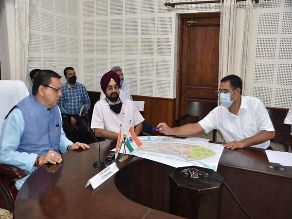 visuals from CM Pushkar Singh Dhami reviewing the development work.