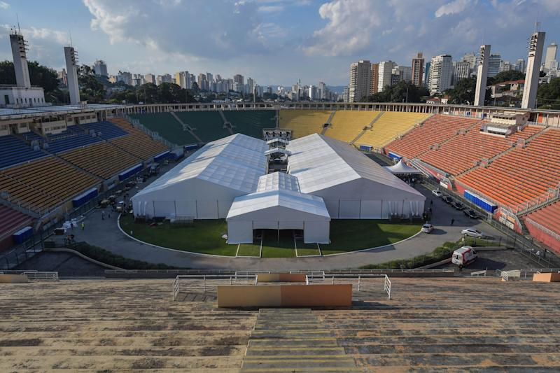 TOPSHOT - View of a temporary field hospital set up for coronavirus patients at Pacaembu stadium, in Sao Paulo, Brazil on March 27, 2020. - Brazil's top football clubs are handing over their stadiums to allow health authorities to turn them into field hospitals and clinics to fight the coronavirus pandemic. (Photo by NELSON ALMEIDA / AFP) (Photo by NELSON ALMEIDA/AFP via Getty Images)