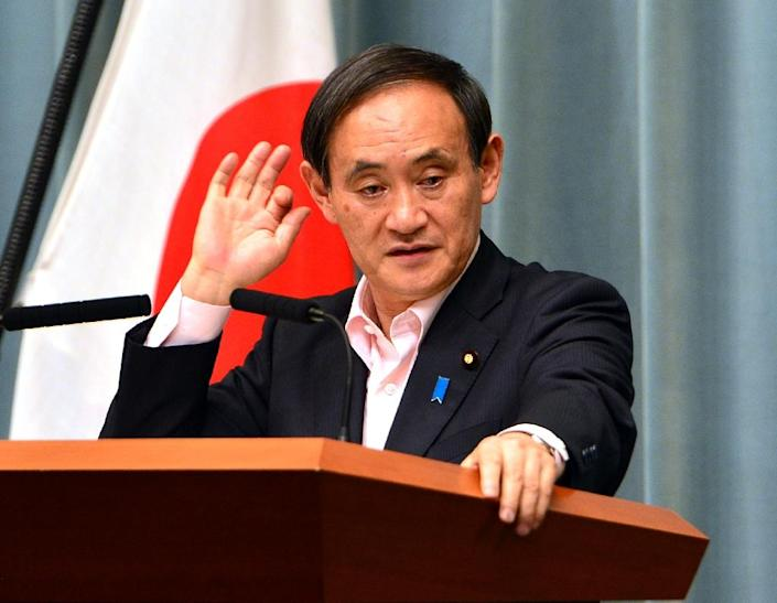 Japan's Chief Cabinet Secretary Yoshihide Suga, pictured during a press conference in Tokyo, in May 2014 (AFP Photo/Yoshikazu Tsuno)