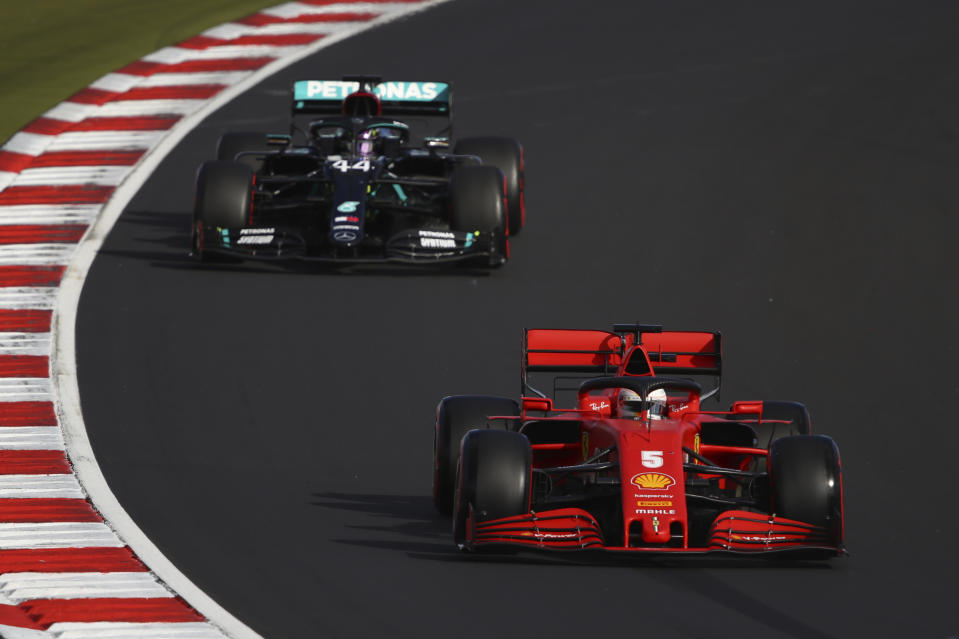 Ferrari driver Sebastian Vettel of Germany steers his car followed by Mercedes driver Lewis Hamilton of Britain during qualification for the Eifel Formula One Grand Prix at the Nuerburgring racetrack in Nuerburg, Germany, Saturday, Oct. 10, 2020. The Germany F1 Grand Prix will be held on Sunday. (Bryn Lennon, Pool via AP)